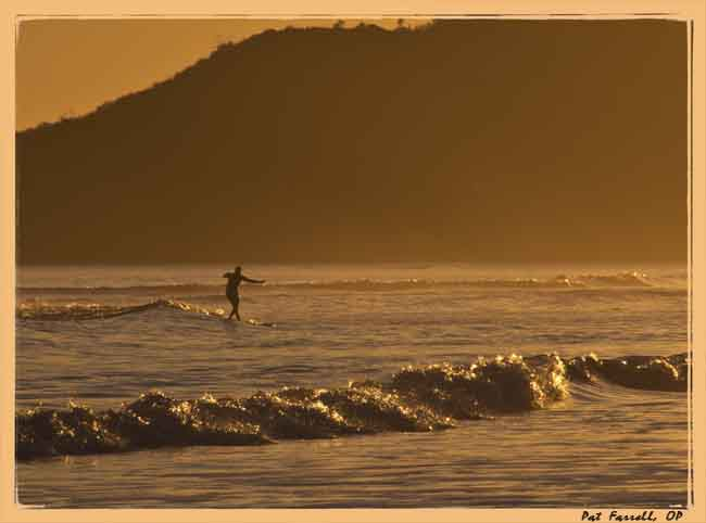 No matter the hour, this surfer certainly considers this moment to be golden