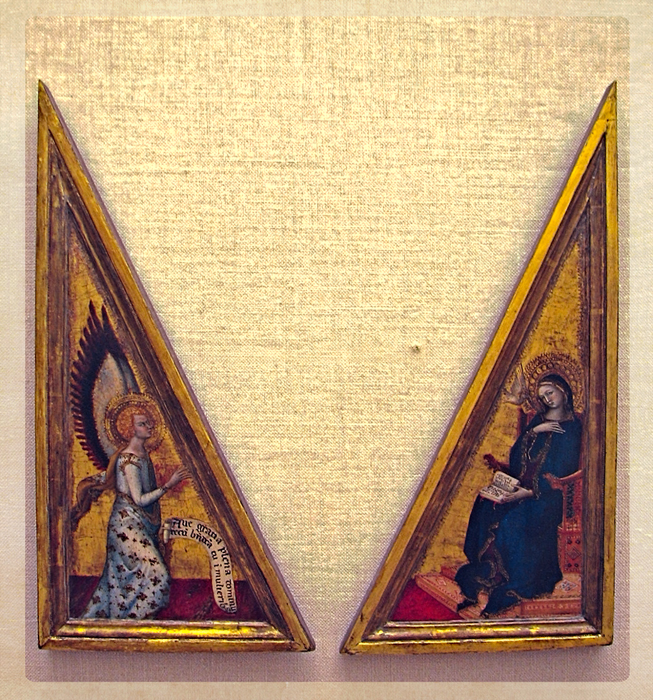 This diptych of The Annunciation hangs in the Louvre in Paris. Unfortunately, I don't know the artist.