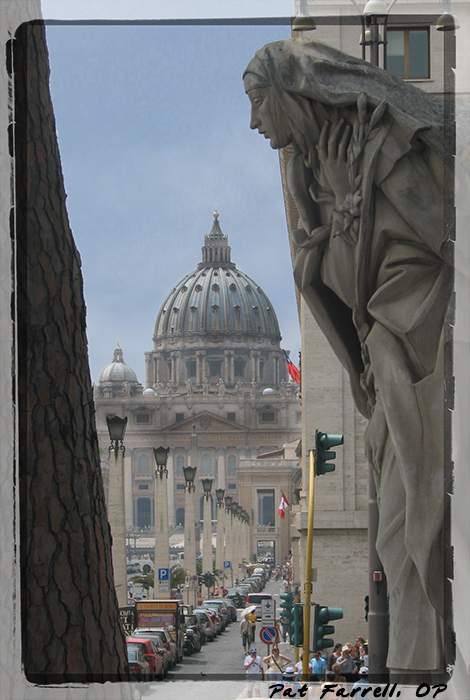 Traffic light in Vatican City by statue of St. Catherine of Siena